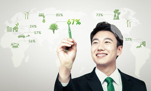 a businessman clicking at world map with green energy
